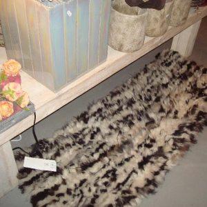 Kortharig schapenhaar kleed
