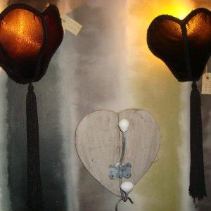 Zwarte wandlamp met sliertjes